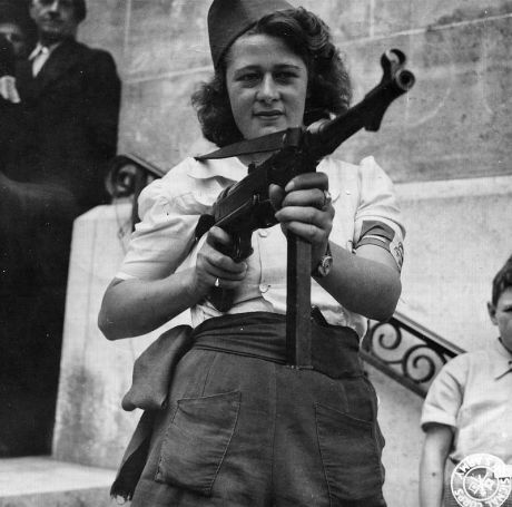 -Nicole-_a_French_Partisan_Who_Captured_25_Nazis_in_the_Chartres_Area,_in_Addition_to_Liquidating_Others,_Poses_with..._-_NARA_-_5957431_-_cropped