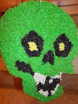 vintage-green-skull-skeleton-head-melted-plastic-popcorn-halloween-decoration-a7d148e6a27d560406e74249c2da7169-1