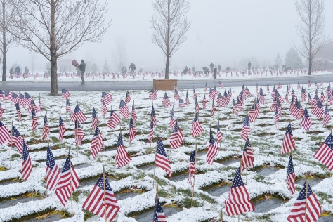 Airmen place flags, honor Veterans Day